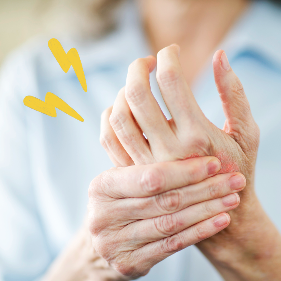 Person holding their hand feeling joint pain
