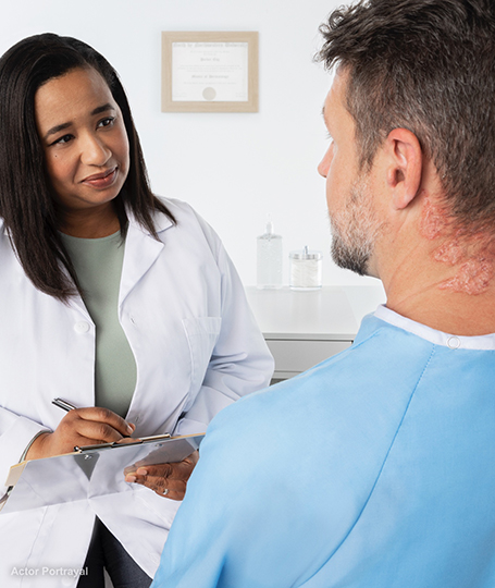 Dermatologist and psoriasis patient talking